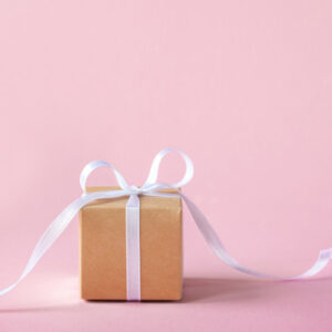 gift present box with white ribbon pink background 90791 1433